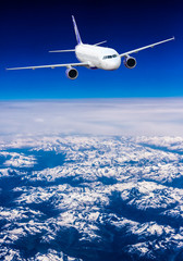 aeroplane.  Airplane over the mountains