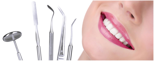 Teeth care concept. Healthy teeth and dental tools.