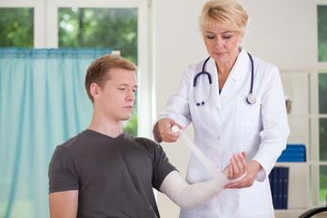 Doctor parcels patient's hand