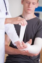 Man with broken hand