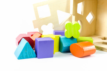 colorful wooden toy blocks isolated on white
