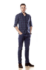 young man posing with his hands in pockets
