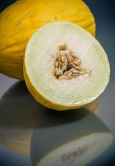 fresh yellow korean melon cut and whole closeup