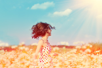 Young happy girl walking on the buckwheat field
