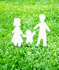 Paper Family icon on green grass