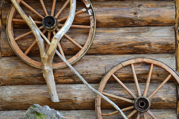 Rural landscape with old wooden wheels (background for message b