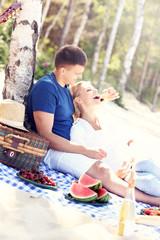 Romantic couple having picnic at the beach