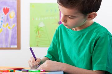 Boy paints on art lessons