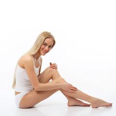 Beautiful woman massaging his legs