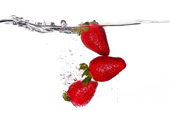Fresh Strawberries in Water Isolated on White. Organic food