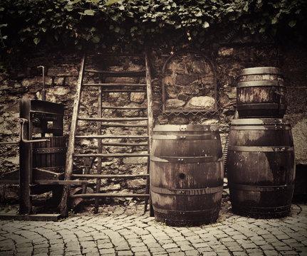 Old traditional wine press and oak barrels