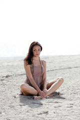 Woman in zen on the sand