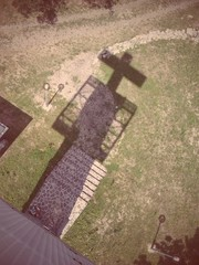 Cross shadow on the ground
