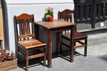 Wooden chairs and table, street rest