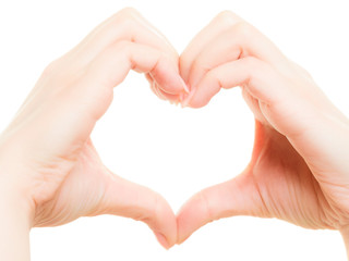 Female hands showing heart shape symbol of love