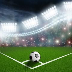 soccer ball on the green field corner