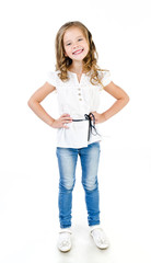 Cute smiling little girl in jeans isolated