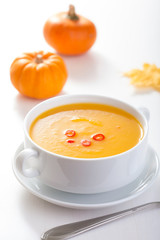 pumpkin soup in white bowl