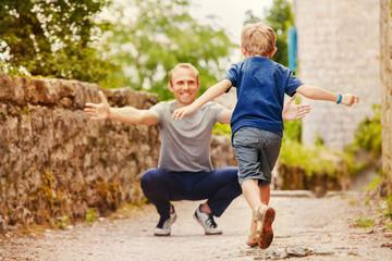 Son runs to daddy's arms