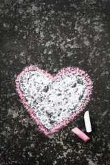 heart drawn in chalk on concrete