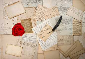 old letters, handwritings, vintage postcards and red rose