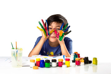 Young asian boy with hands in paint