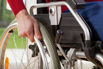 Close-up on wheelchair of capable disabled