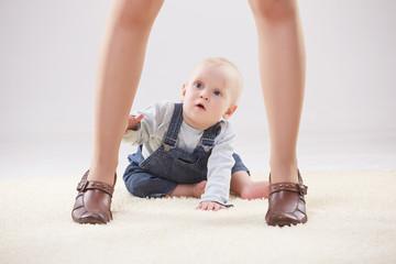 baby  between the legs of mom