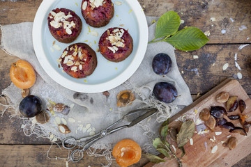 fruits vegan cupcakes with apricots and prunes on rustic table