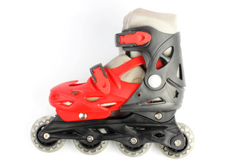 Red & Black Colored roller skates isolated on white
