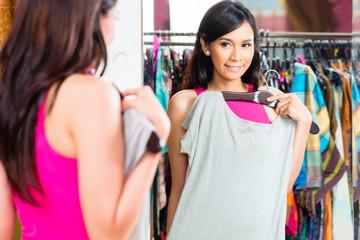 Asian woman shopping in fashion store Wall mural