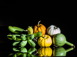 still life lightpaint color-full little pumpkins and banana