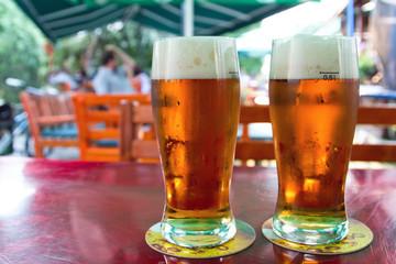 Two beers in garden pub