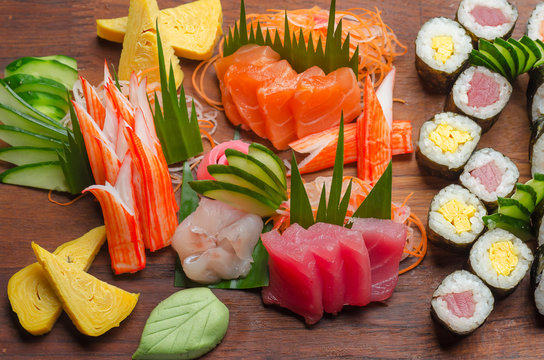 Down top view of sushi platter on a wooden board