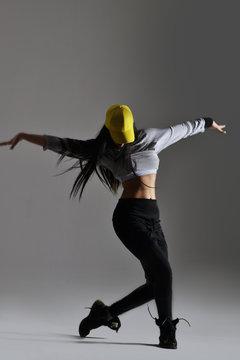 beautiful young woman dancing, studio shot
