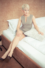 beautiful girl resting on the bed - colorized photo