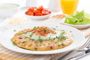 dietary omelette with carrot, green yogurt sauce for breakfast
