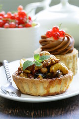 small dessert pastries with nuts and berries for tea time