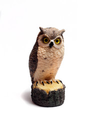 owl figurine is made of wood