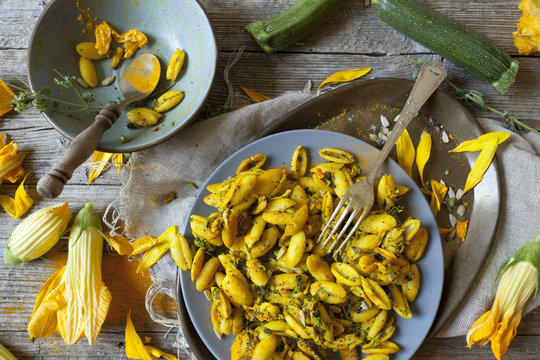 yellow summer flowers pasta with seeds and petals flowers