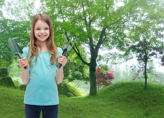smiling little girl with rake and scoop