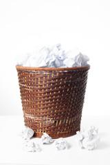 Paper bin full of paper balls