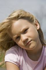 Thoughtful looking young girl outdoors