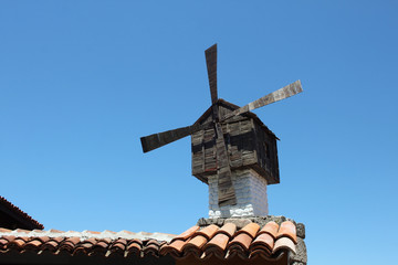 Old windmill on the roof of ancient house, Sozopol, Bulgaria
