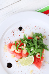 Salad with watermelon, feta, arugula, shrimps, balsamic sauce