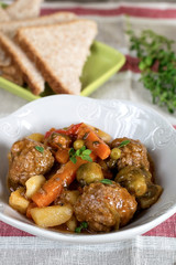 Vegetable stew with meatballs and thick gravy