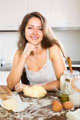 cook making dough