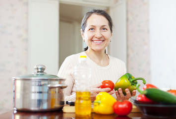mature woman cooking veggie lunch