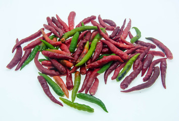 Red and green chilli peppers on white background