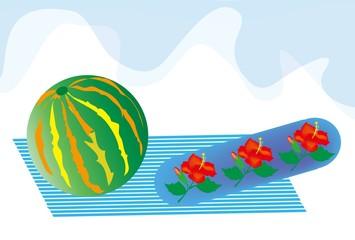 スイカのビーチボールと海辺のイメージ